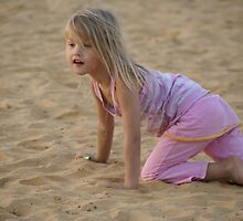 Young girl playing in the sand by Moshe Cohen