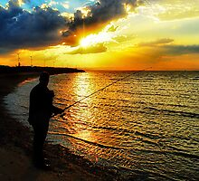 Fishing at sunset... by Nicole Goggins