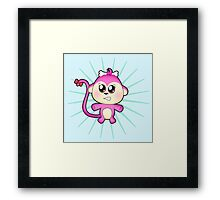 Cute baby zoo animal monkey up to mischief Framed Print