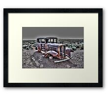 Rusting in the desert Framed Print