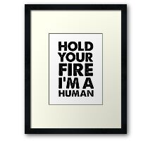 Hold your fire I'm a human Framed Print
