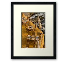 Tables at sea Framed Print