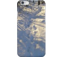 Footpath in snow a sunny winter day. iPhone Case/Skin