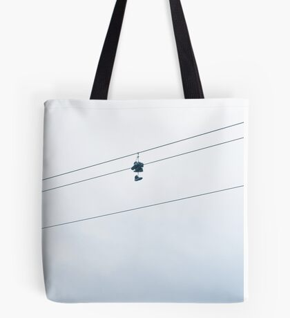 Boots hanging from a power line Tote Bag