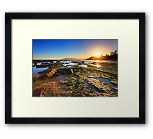 Golden Sunrays stretch across the reefs at sunset Framed Print