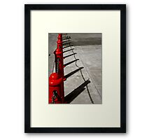 Red Poles Framed Print