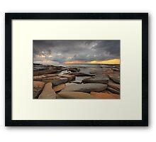 Sunrise, rocks and storm clouds Framed Print