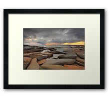 Sunrise, rocks and storm clouds Framed Print