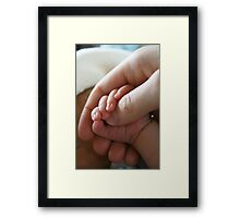 Mommy's Touch Framed Print