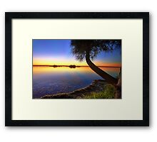 Sunbeams reflected in the water at sunset  seascape Framed Print