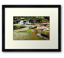 Tranquility waterfalls and moss covered rocks Framed Print