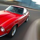 Red Datsun 260Z rig shot by John Jovic
