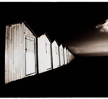 beach huts at rest by ragman
