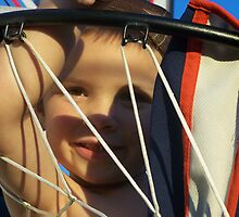 kid in basketball goal by tomcat2170