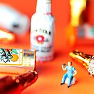 Drinking Among Liquor Filled Chocolate Bottles by Paul Ge