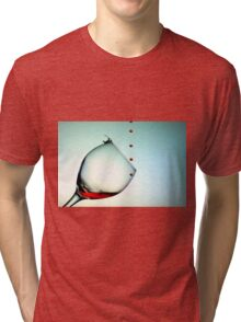 Fishing On A Glass Cup With Red Wine Droplets Tri-blend T-Shirt