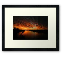 Fire in the evening sky  Framed Print