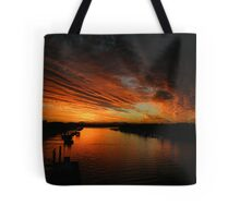 Fire in the evening sky  Tote Bag