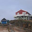 red house on stilts by jdworldly