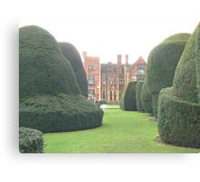 Heslington Hall From The Topiary Garden. Canvas Print