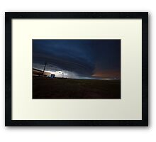 Train into the storm Framed Print