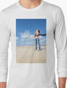 Spiritual young woman communicates with the spirits on a beach Long Sleeve T-Shirt