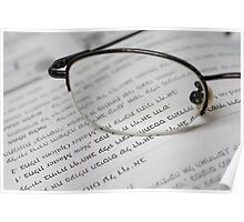 reading glasses on an open book with text in Hebrew Poster