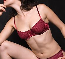 Glamour model Jenny in red lingerie on black by leoklein