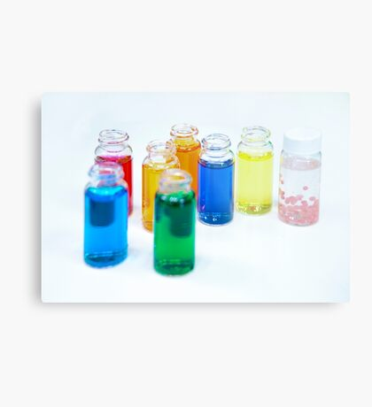 Glass bottles with coloured liquid at a Cosmetics manufacturer Metal Print