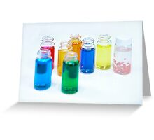Glass bottles with coloured liquid at a Cosmetics manufacturer Greeting Card
