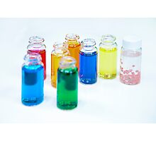 Glass bottles with coloured liquid at a Cosmetics manufacturer Photographic Print