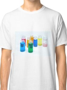 Glass bottles with coloured liquid at a Cosmetics manufacturer Classic T-Shirt