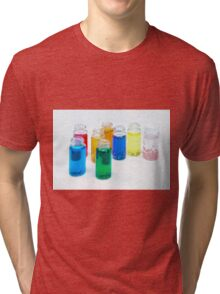 Glass bottles with coloured liquid at a Cosmetics manufacturer Tri-blend T-Shirt