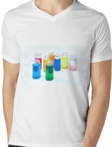 Glass bottles with coloured liquid at a Cosmetics manufacturer Mens V-Neck T-Shirt