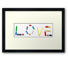 Love written with a child's colourful building blocks Framed Print