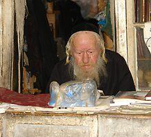 Rabbi in his shop in the neighborhood of Mea She'arim. by dominiquelandau