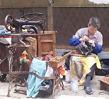 Street Shoemaker by JenniferC