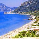 Agios Gordios Bay by Tom Gomez