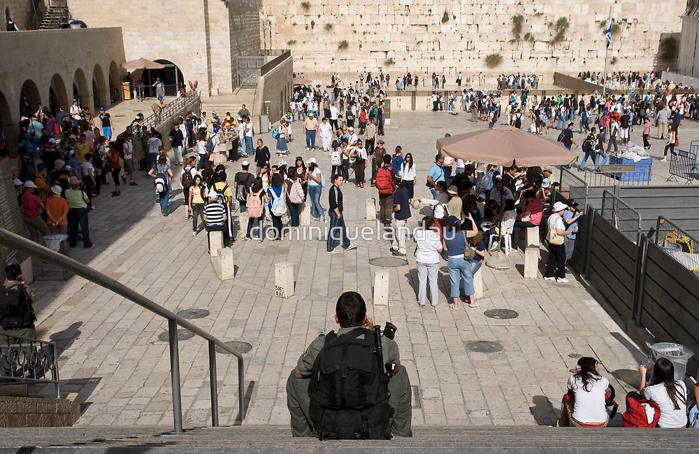 Taking a break in front of the Western Wall. by dominiquelandau