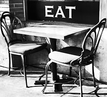 Table at an Outdoor Cafe by robemkeefe