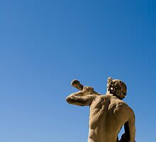 Statue of man against blue sky by mossko
