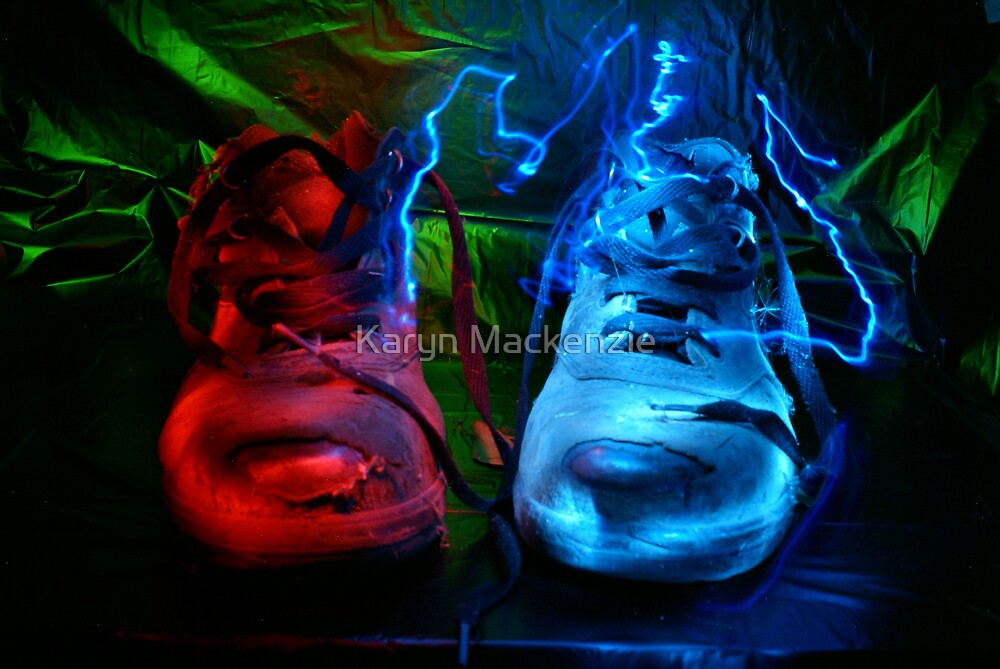 Old boots painted with light by Karyn Mackenzie