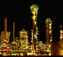 Esso refinery at night by Martijn Budding