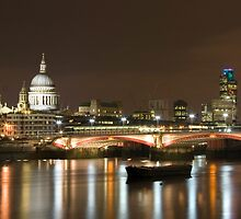 St Paul's at night over the river Thames, London by Andrew Conn