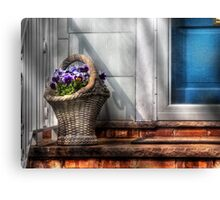 Basket of flowers Canvas Print