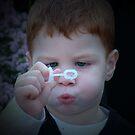 Zac Blowing a Bubble  by tess1731