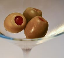 Green Olives in a Martini Glass by lisavonbiela