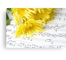 chrysanthemum laying on sheet music Canvas Print
