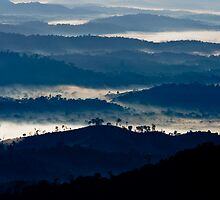 Clouds nestle among mountains in southern Bahia, Brazil by robinmoore