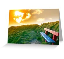 bench on a cliff edge with sunset Greeting Card